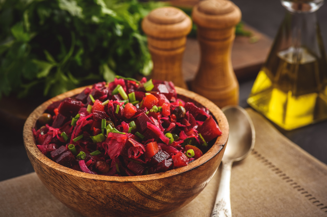 Vegetable salad with beetroot, carrot, pea and onion. Russian style cuisine.